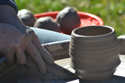 Cups can also be made using pottery clay! This student uses a wheel to shape it into place!