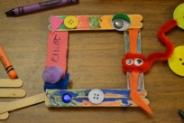 When I got home, I used some popsicle sticks, glue, buttons, and crayons to make a picture frame...now I need to get a picture!!